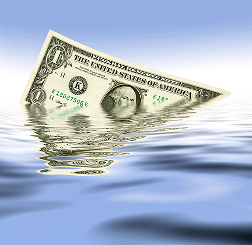 Dollar bill floating in water