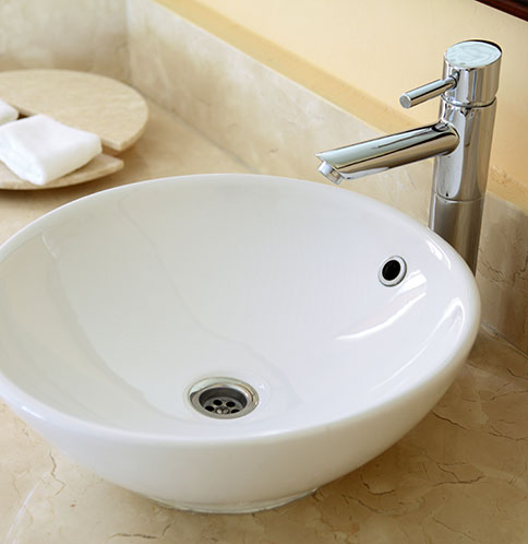 Sink with water efficient faucet
